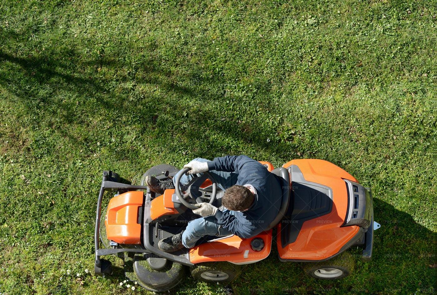 Man Mowing A Lawn: Stock Photos