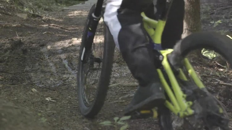 Mountain Biker Climbs Trail: Stock Video