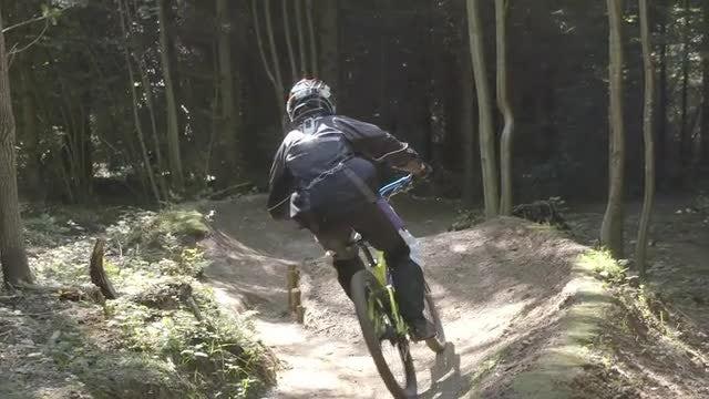Mountain Biker Jumps Off Ramp: Stock Video