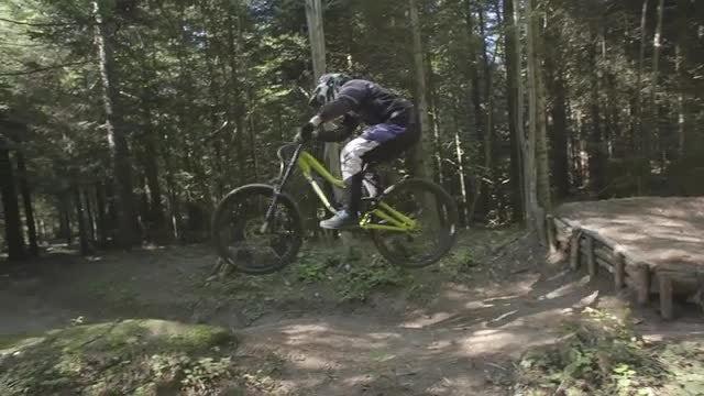 Mountain Biker Jumps Bike: Stock Video