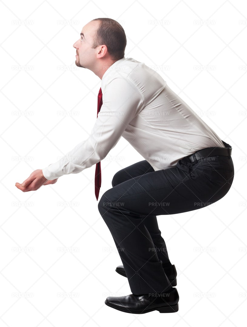 Squatting Businessman: Stock Photos
