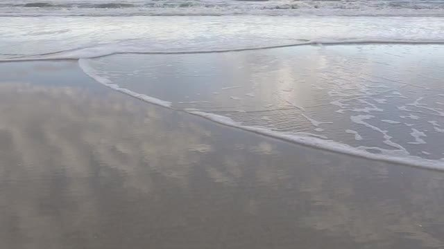 Sky Reflecting On The Beach : Stock Video