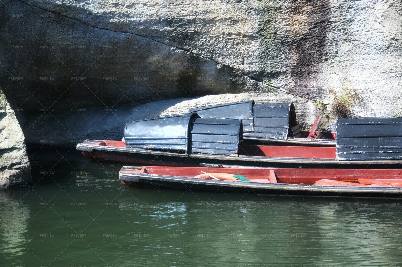 Black Canopied Boats: Stock Photos