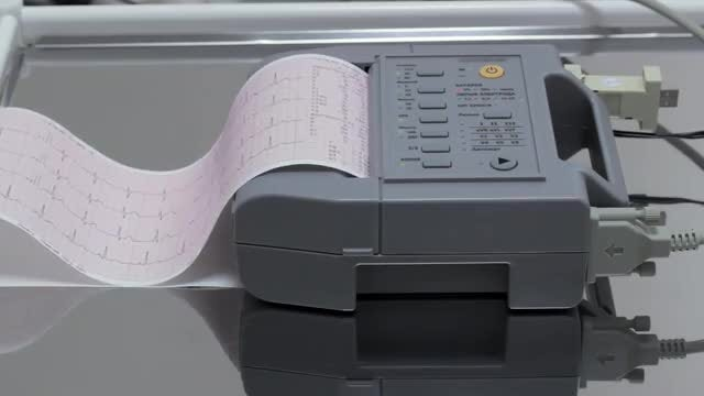 Cardiologist Printing Electrocardiography: Stock Video