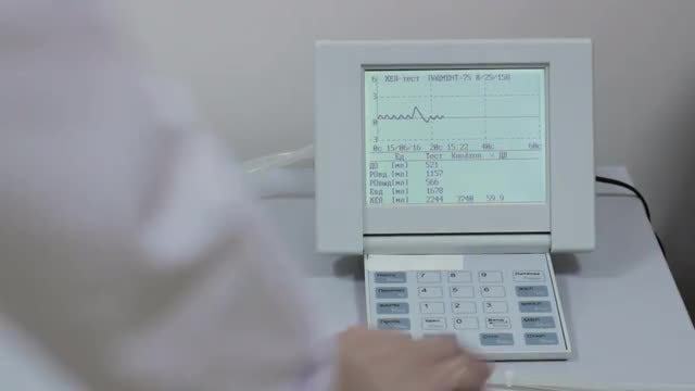 Doctor Operating A Spirometer : Stock Video