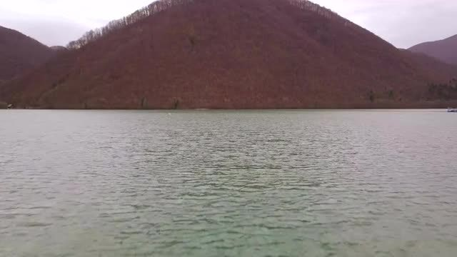 Lake With A Hilly Background: Stock Video