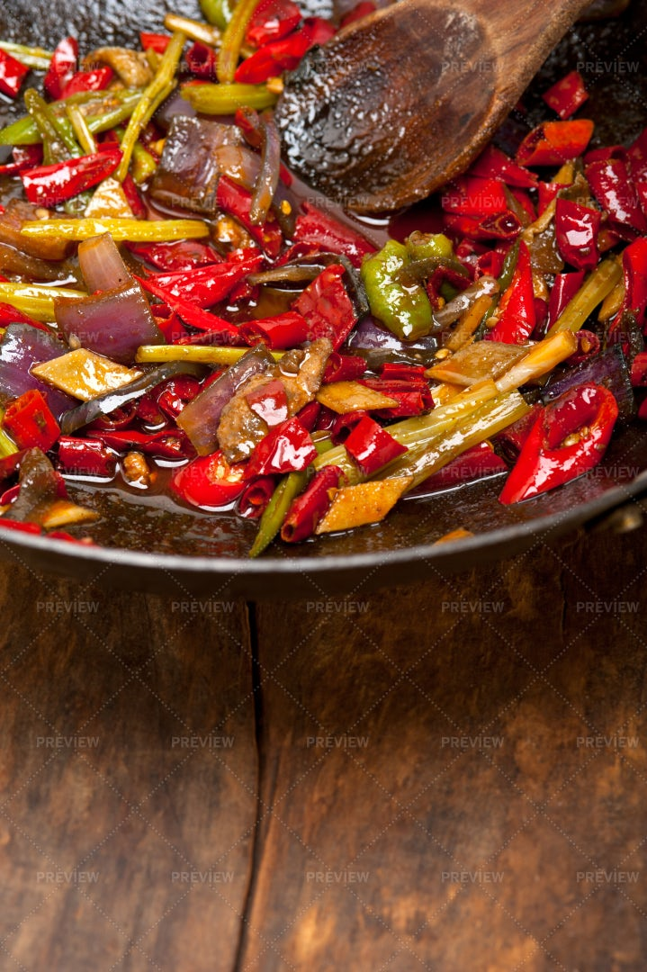 Chili Pepper And Vegetables In A Wok: Stock Photos