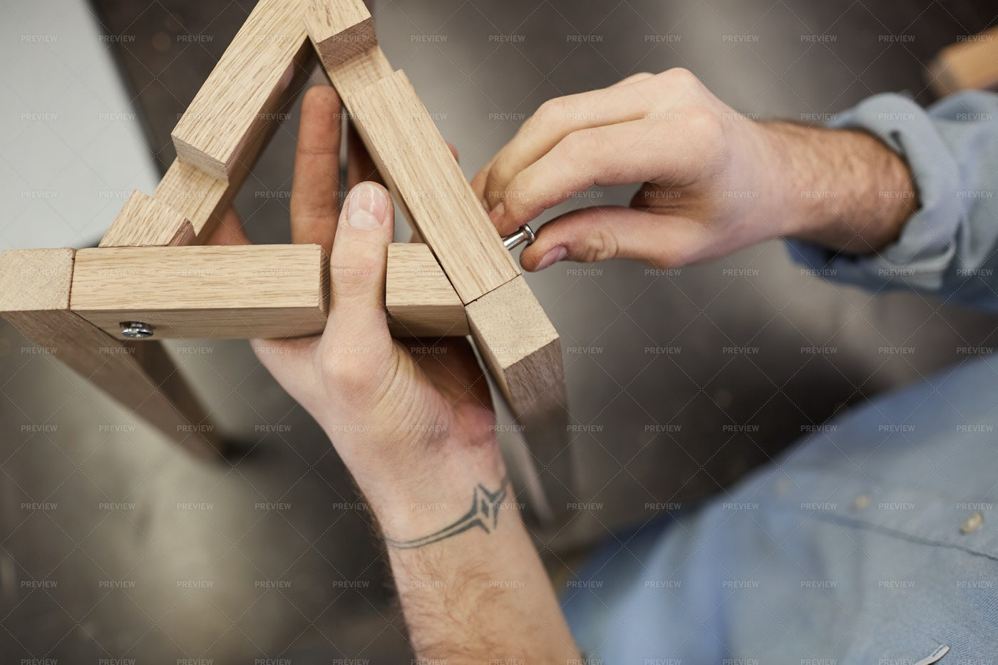Man Making Wooden Figure: Stock Photos