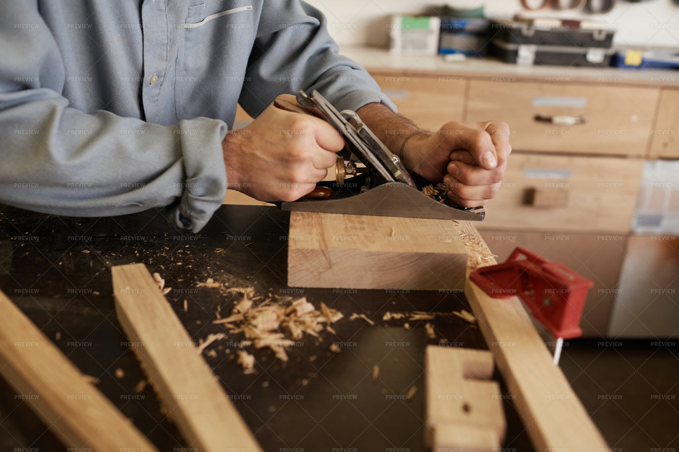 Worker Grinding Wooden Planks: Stock Photos