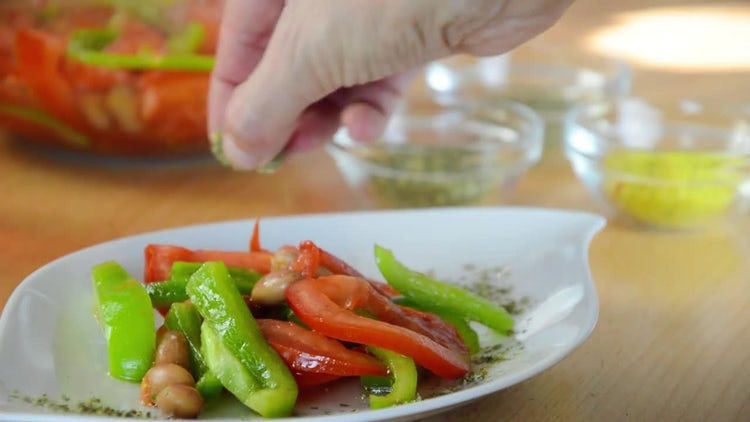 Adding Spice To Mixed Salad: Stock Video