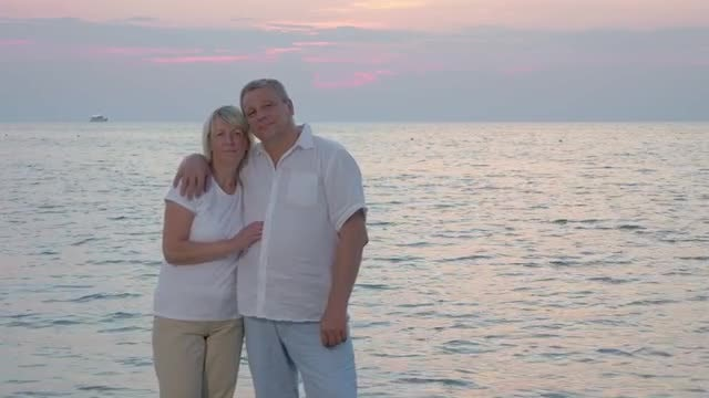 Couple Relaxing On The Beach: Stock Video