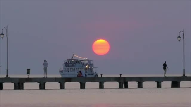 Walking On Pier At Sunset: Stock Video