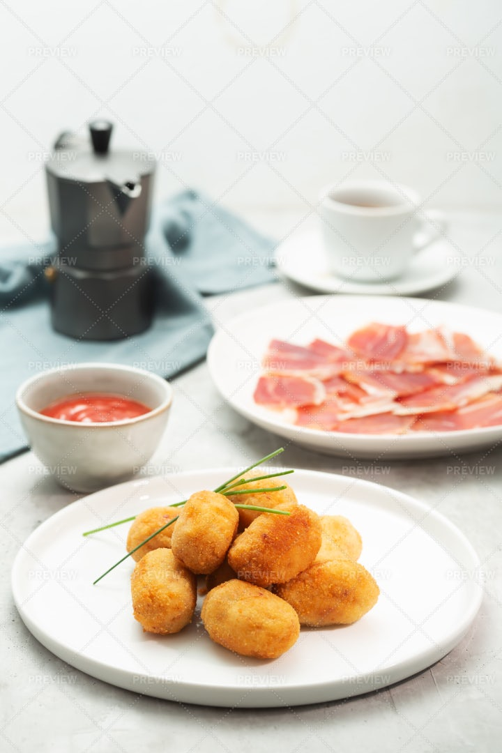 Spanish Tapas Croquettes With Sauce: Stock Photos