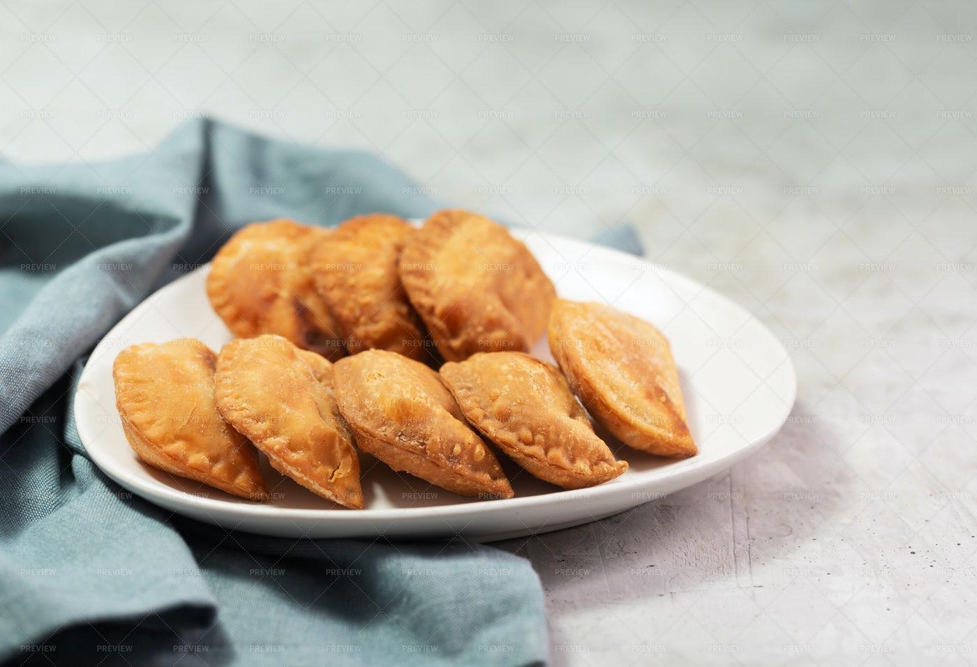 Empanadas On A White Plate: Stock Photos