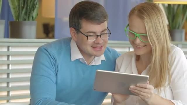 Couple Discussing Something On Tablet : Stock Video