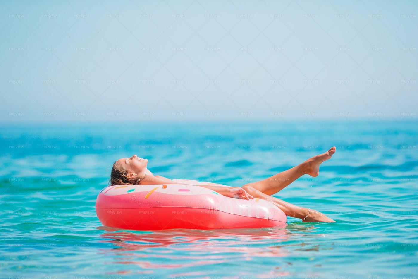 Girl On A Floaty: Stock Photos