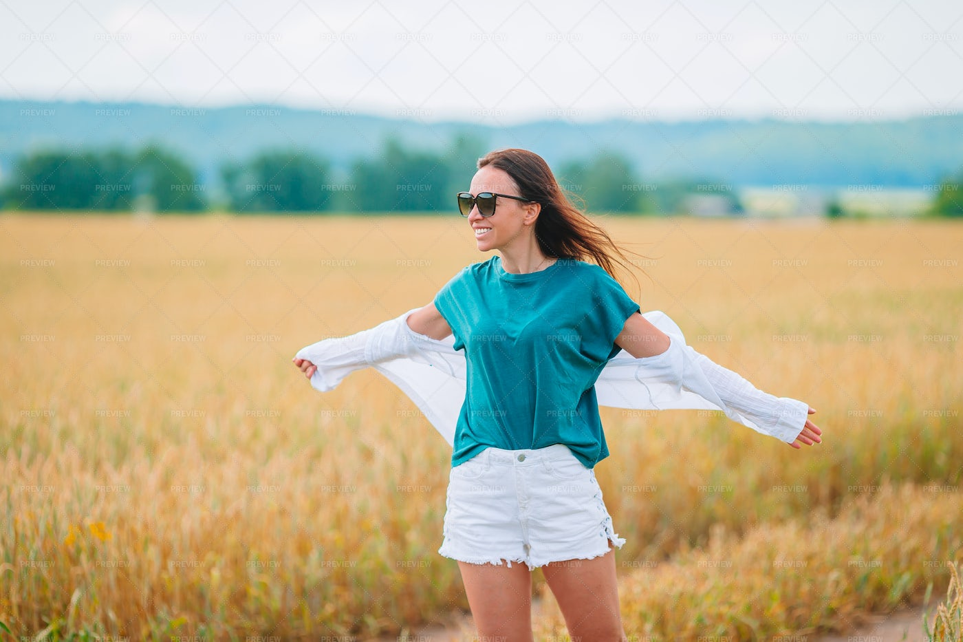 Girl In A Wheat Field: Stock Photos