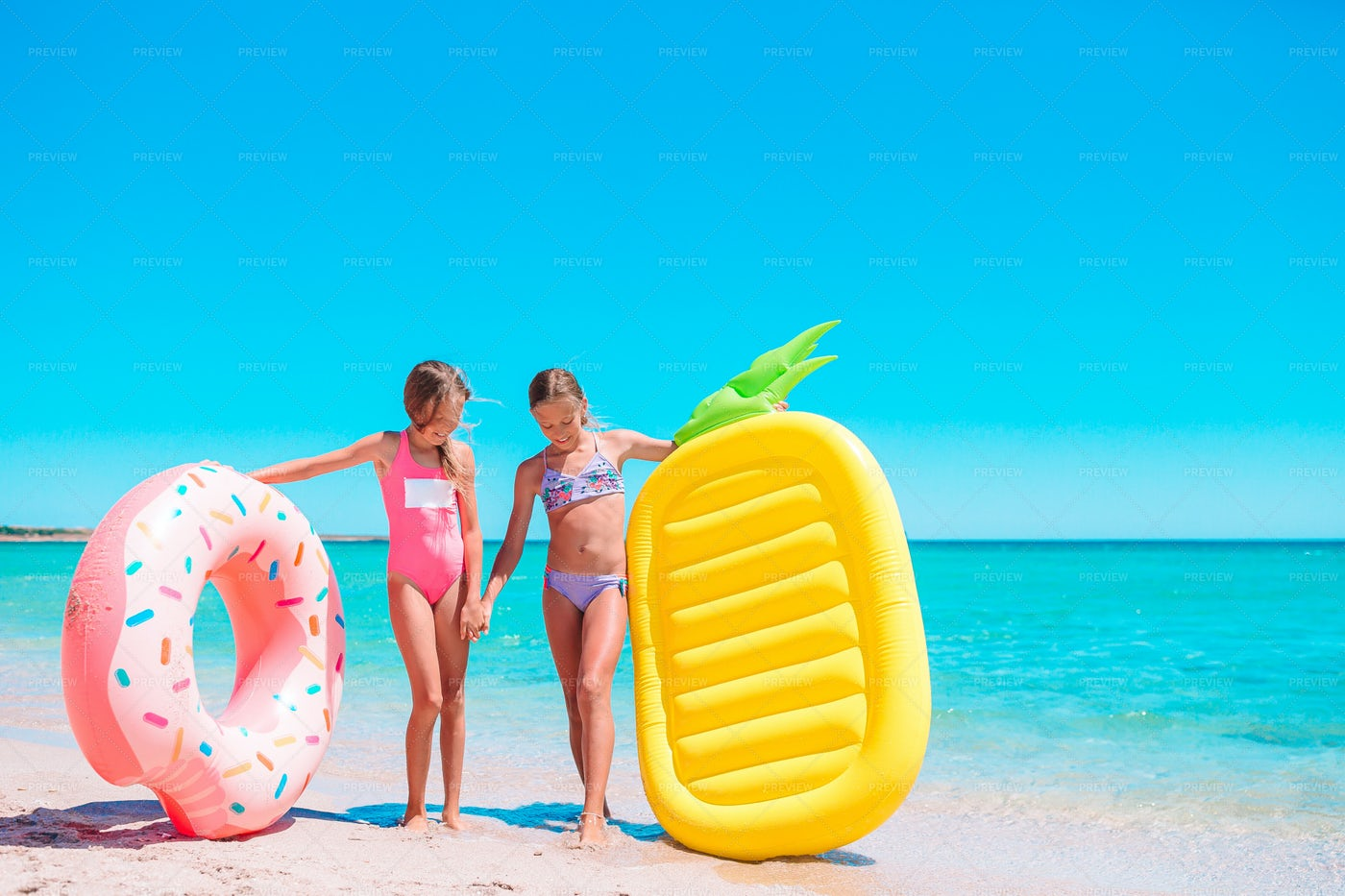 Girls With Their Inflatables: Stock Photos