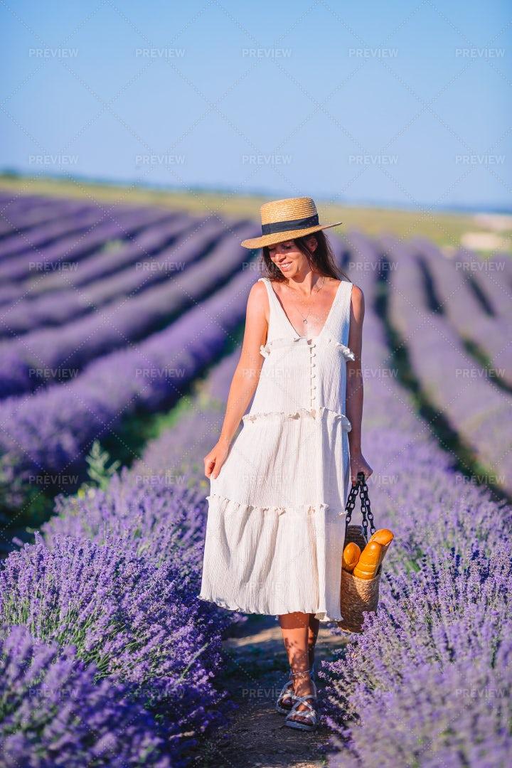 Woman Walking Through Lavender: Stock Photos