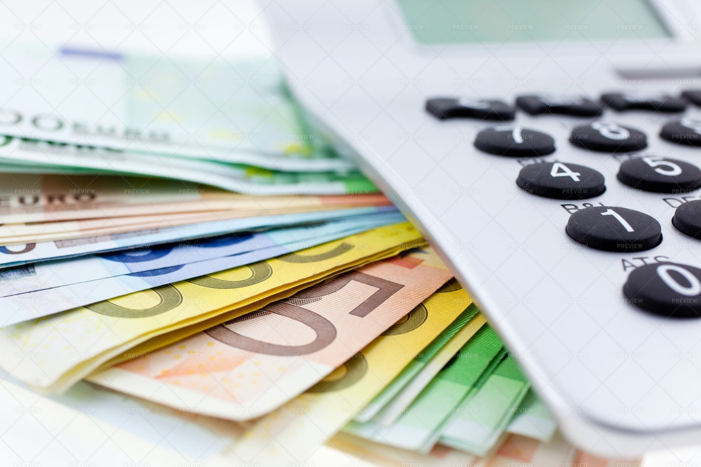 Euros With Calculator: Stock Photos