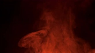 Red Smoke On Black Background: Stock Footage