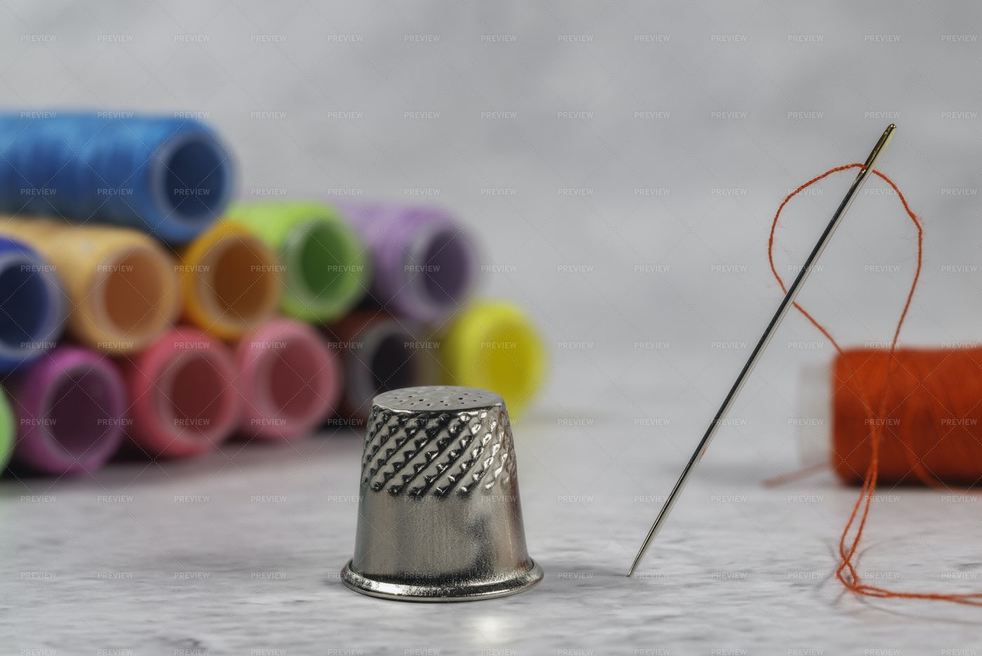 Needle, Thimble And Colorful Spools: Stock Photos
