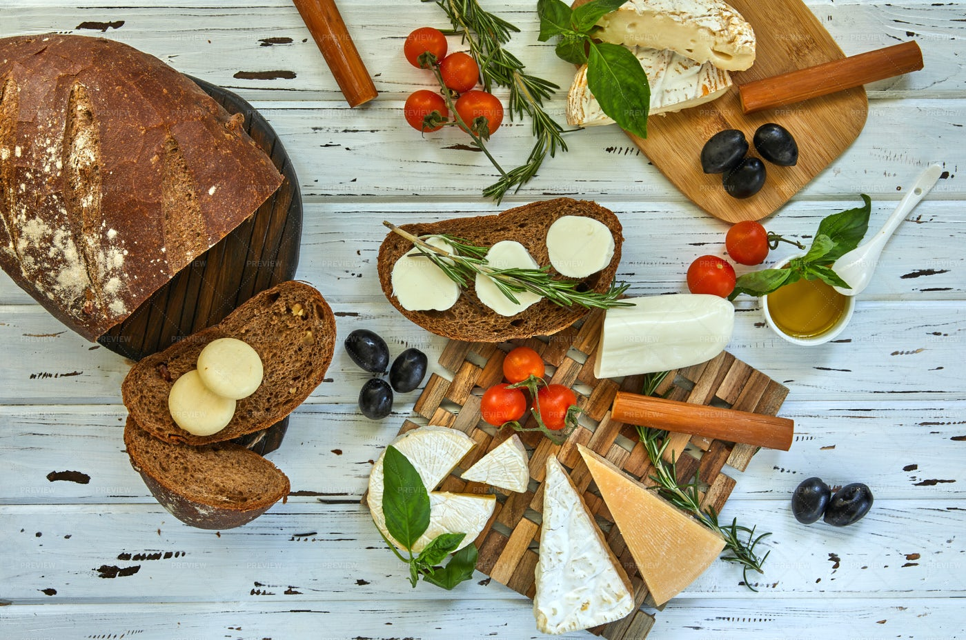 Various Cheeses, Bread And Veg: Stock Photos