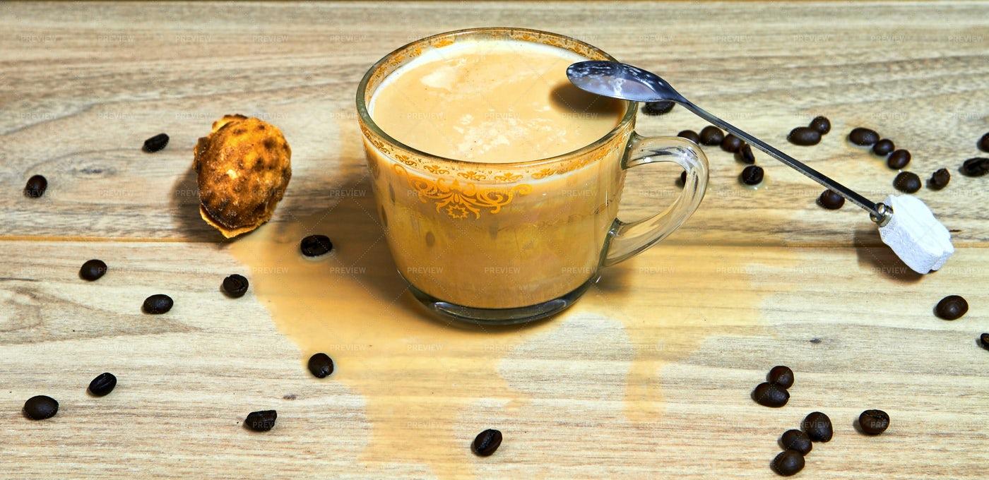 Cappuccino Beside Coffee Beans: Stock Photos