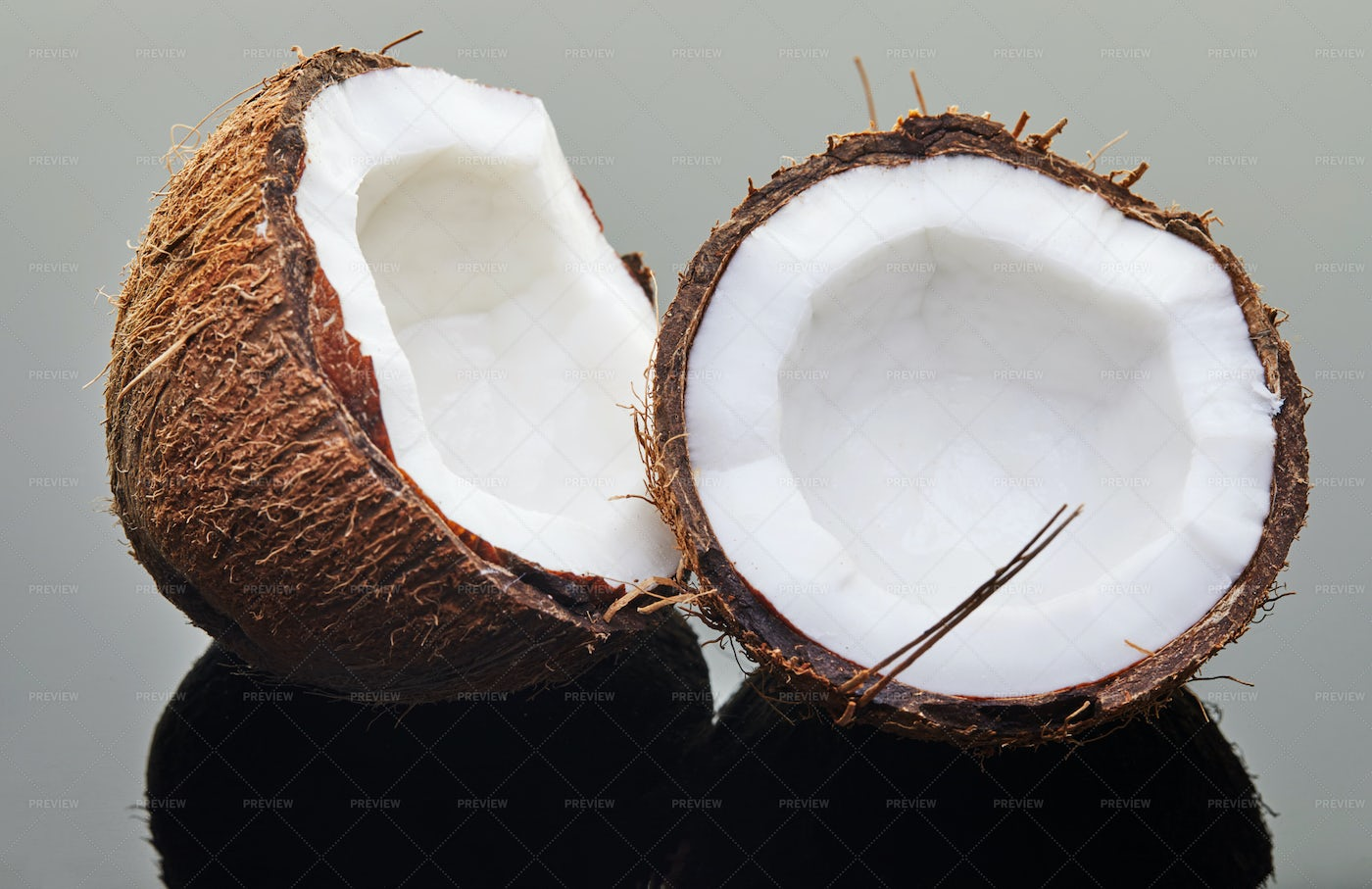 Coconut Chopped Into Two: Stock Photos