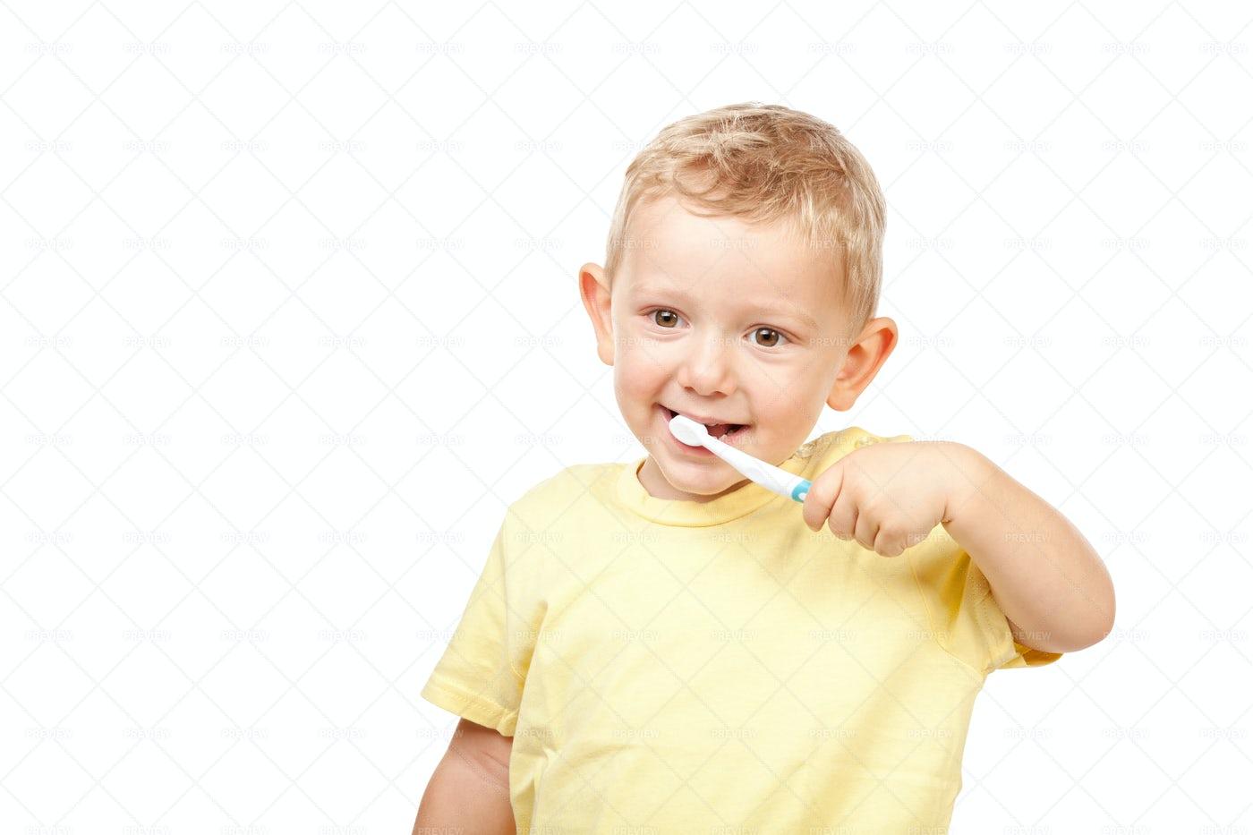 Boy Brushing Teeth: Stock Photos