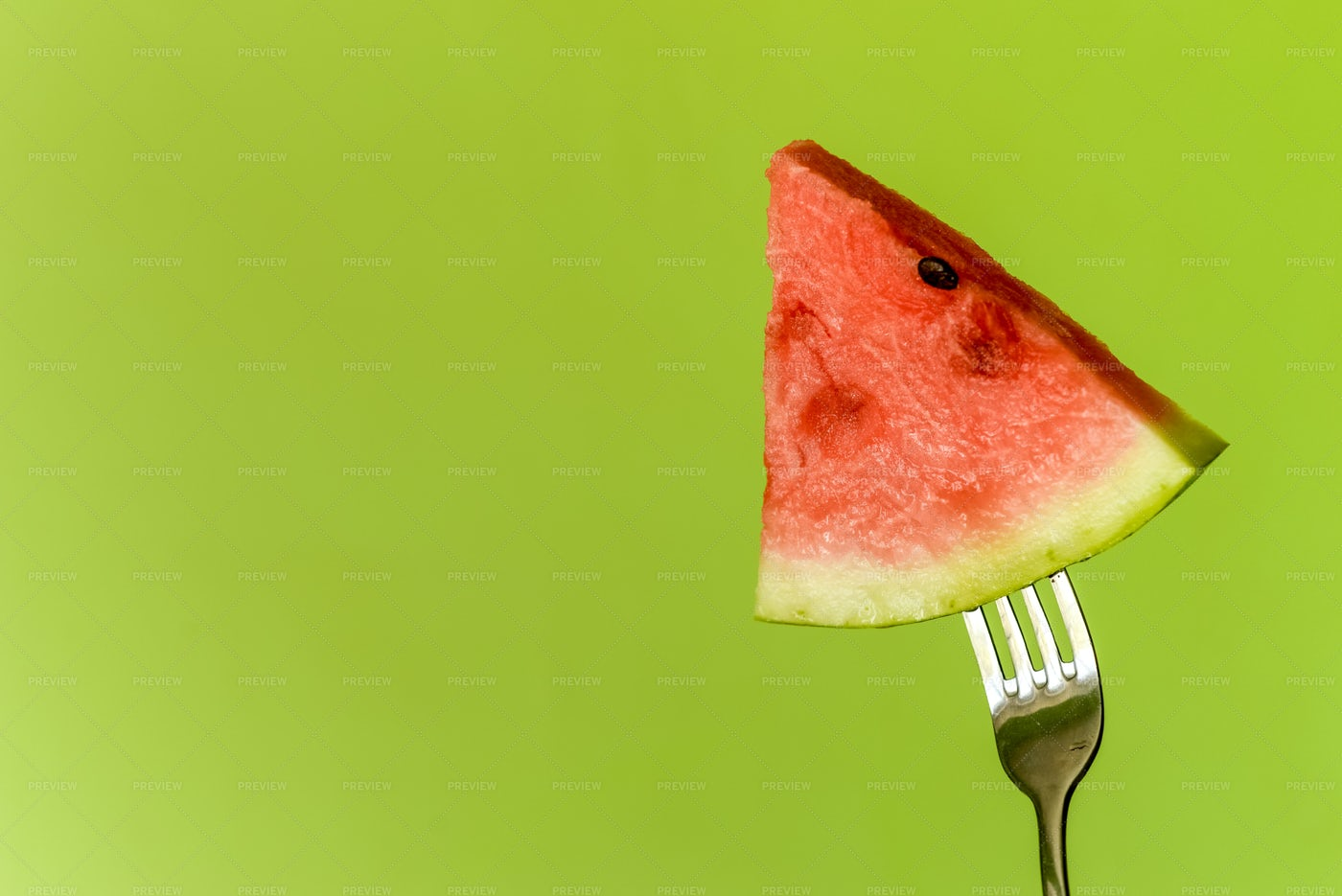 Watermelon On Fork Background: Stock Photos
