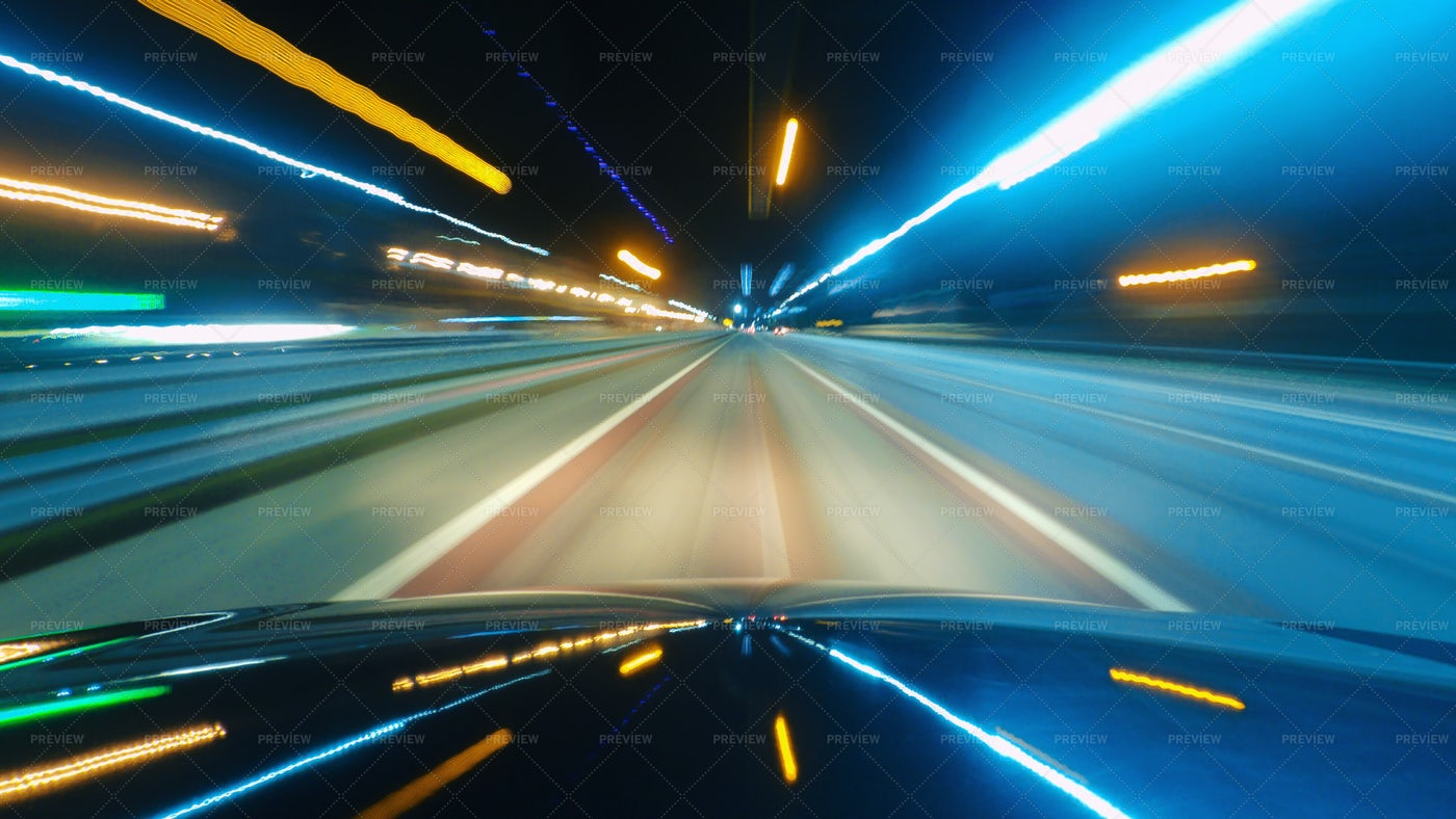 Speeding Car At Night In The City: Stock Photos