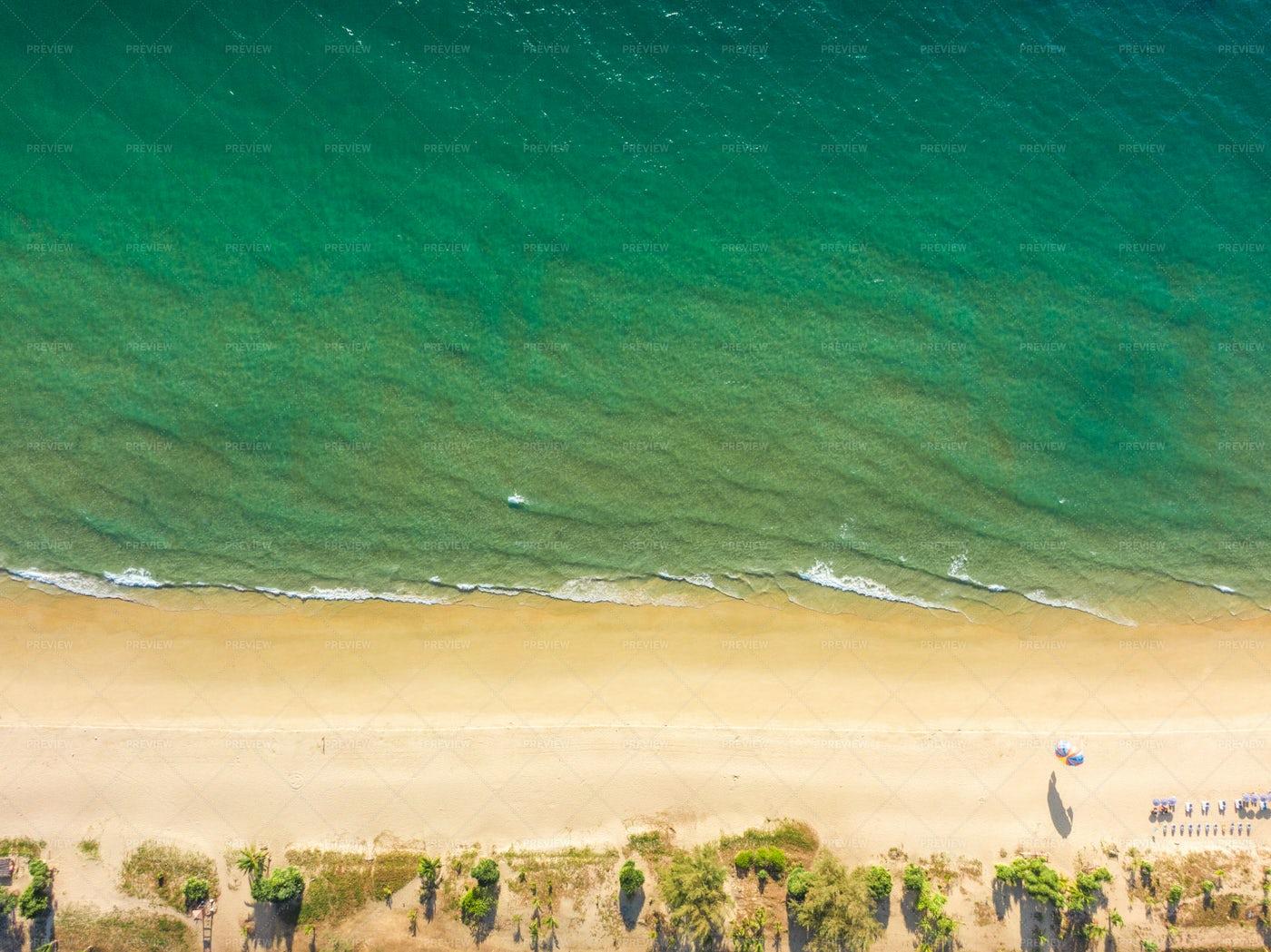 Top View Sandy Beach And Emerald Ocean: Stock Photos