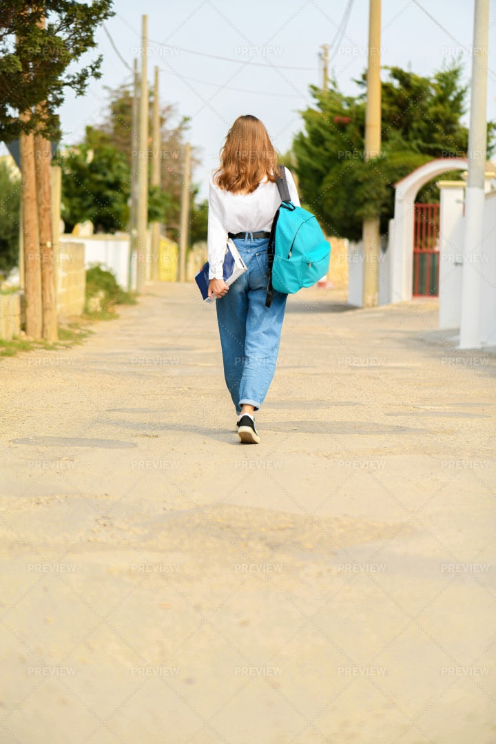 Female Student With Backpack And Book: Stock Photos