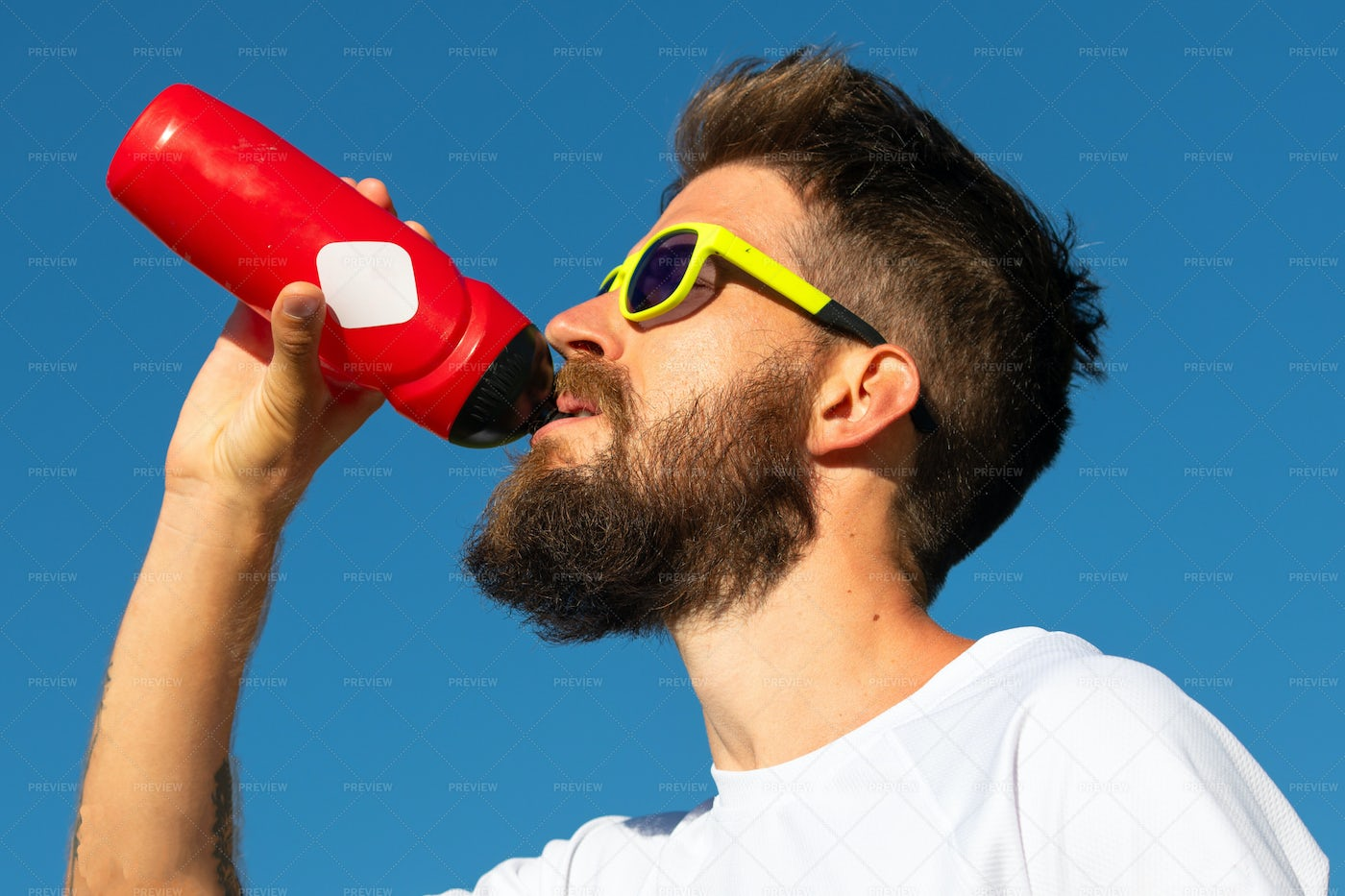 Sporty Man Drinking Water: Stock Photos