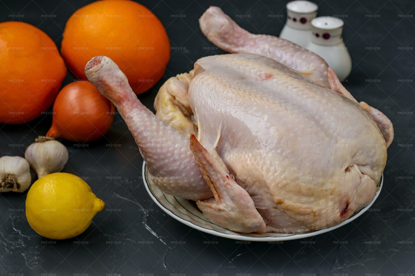 Raw Chicken Prepared For Baking: Stock Photos