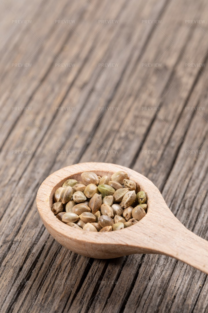 Wooden Spoon With Cannabis Seeds: Stock Photos