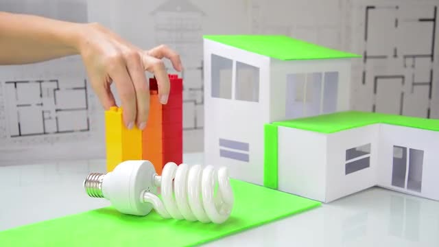Woman Arranging Colored Cubes: Stock Video