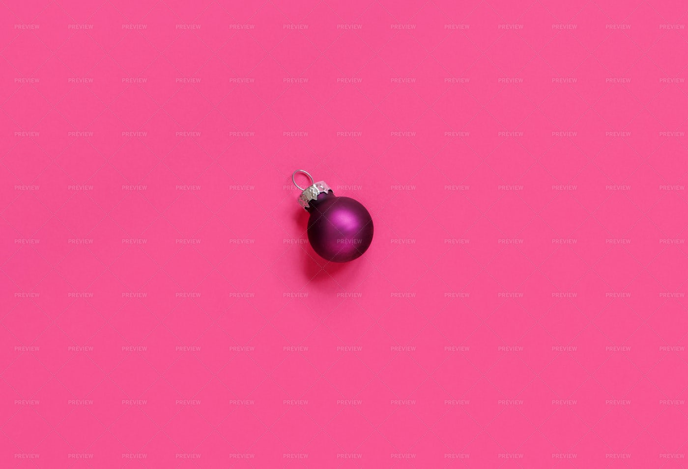 Single Purple Christmas Ornament On Pink: Stock Photos