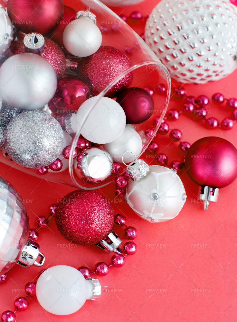 Christmas Baubles On Red Background: Stock Photos
