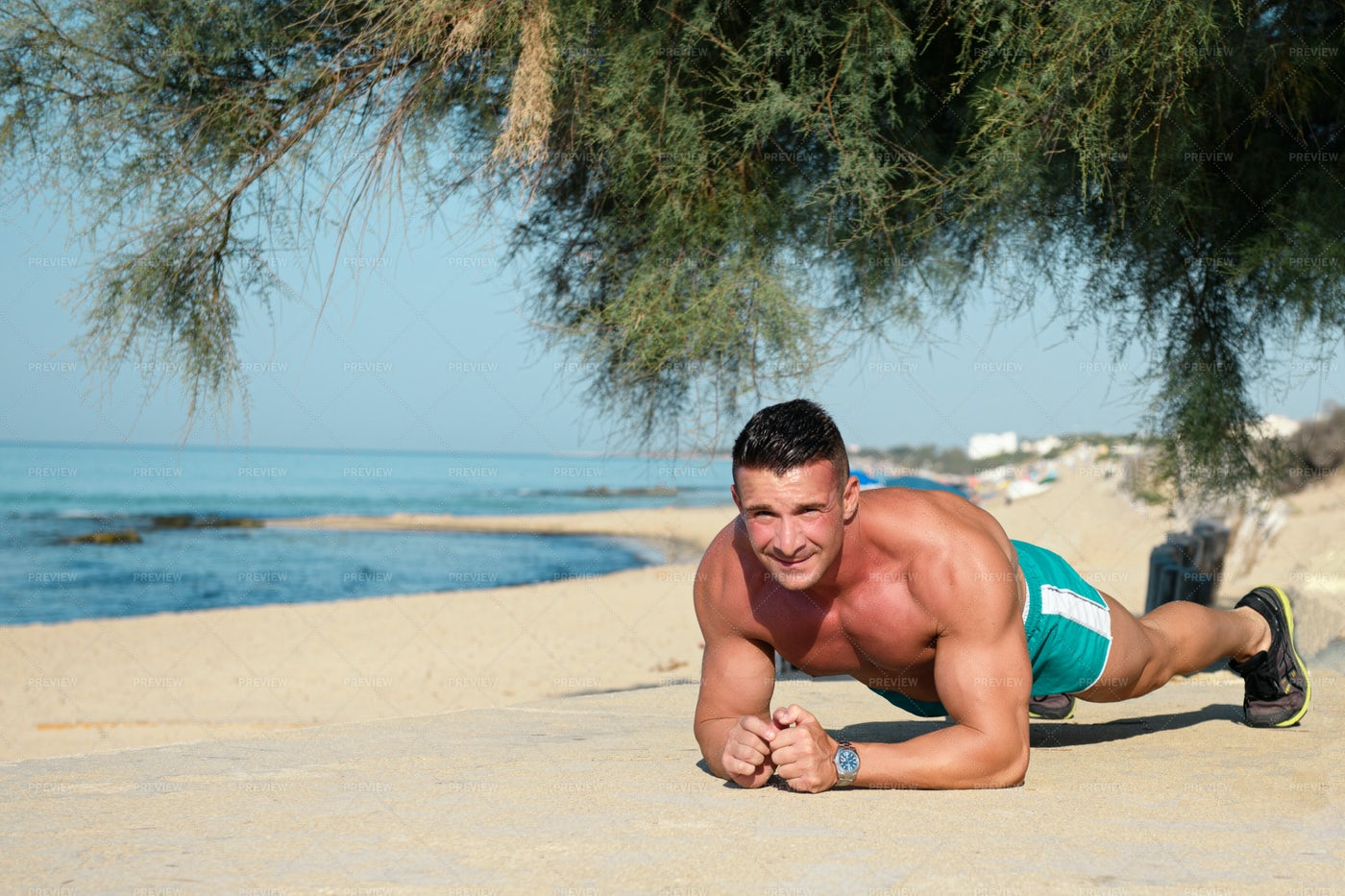 Fit Man Exercising On The Beach: Stock Photos
