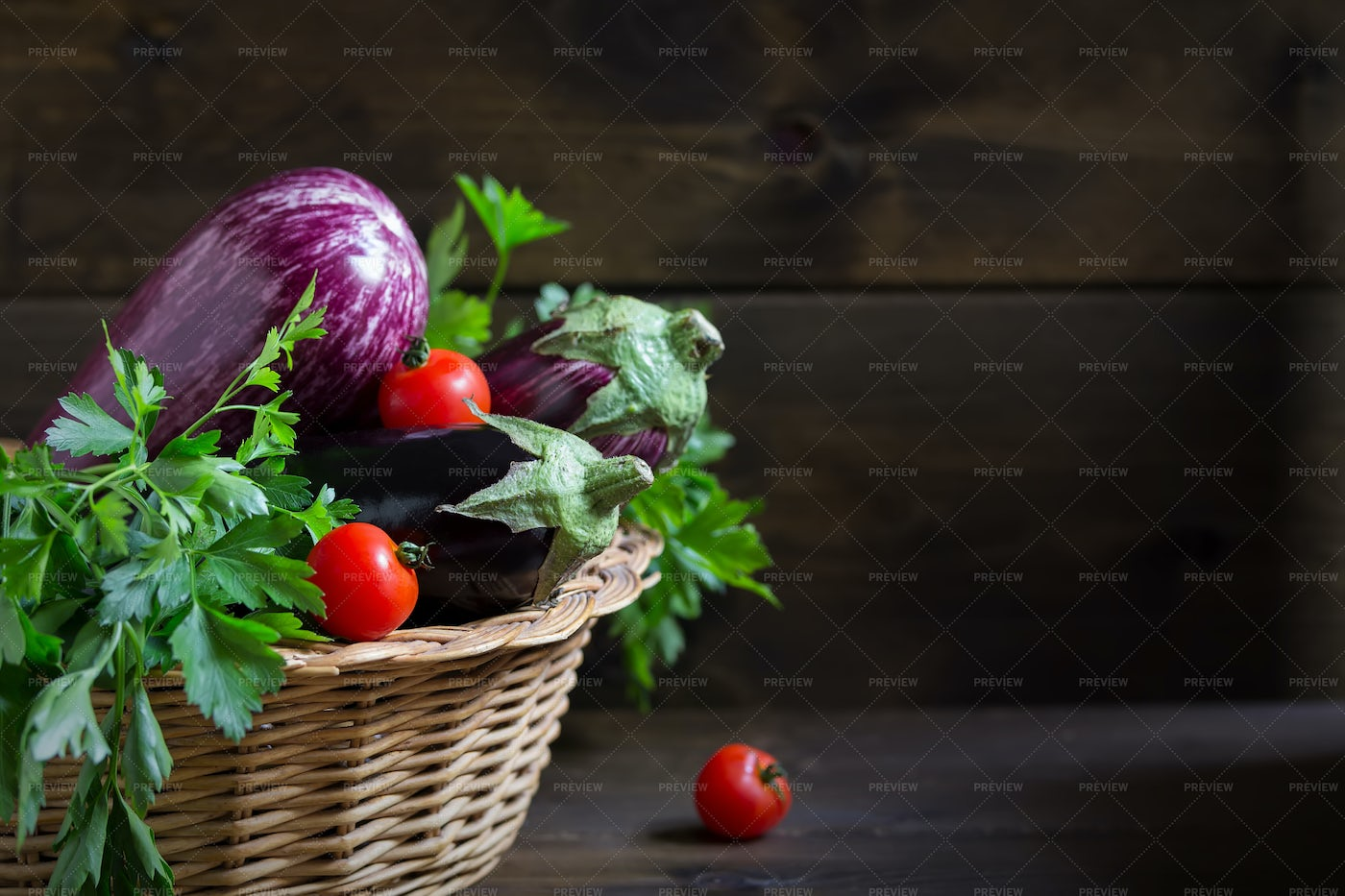 Eggplant In A Basket Background: Stock Photos