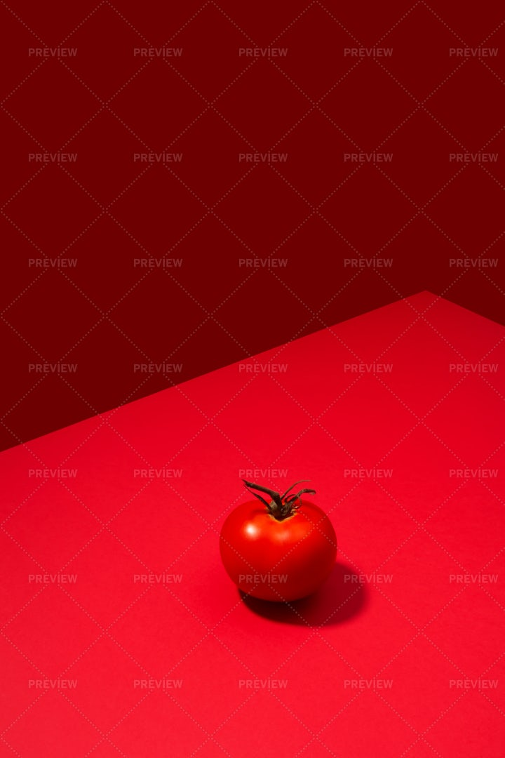 Single Tomato On Red Background: Stock Photos