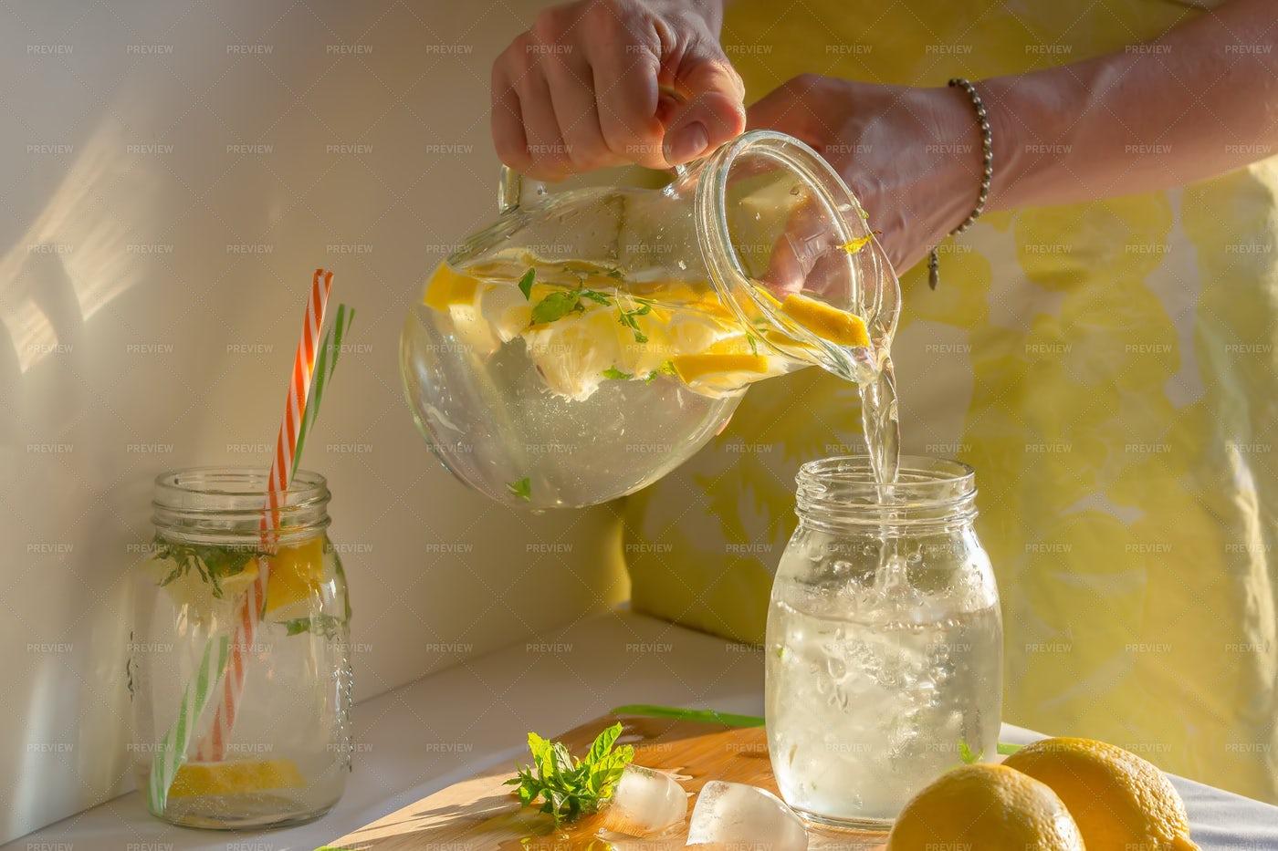 Pouring Homemade Lemonade: Stock Photos
