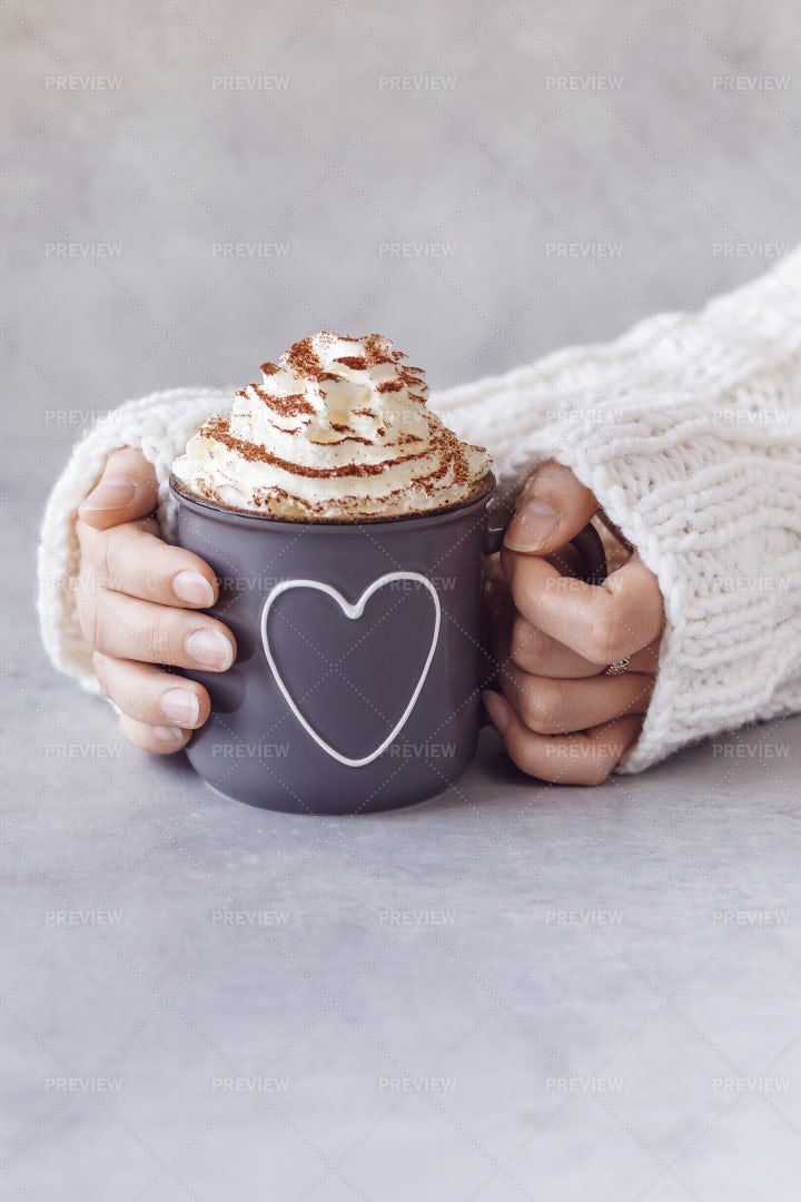 Holding Her Hot Chocolate: Stock Photos