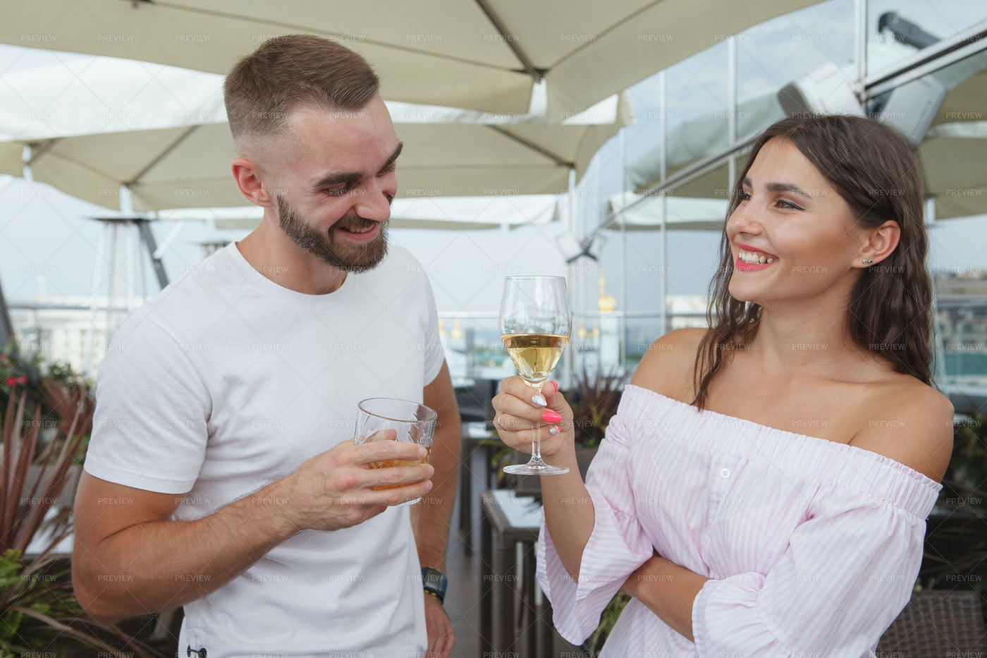 Couple Drinking Wine On A Rooftop: Stock Photos