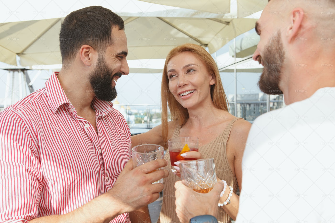 Friends Drinking On A Rooftop Bar: Stock Photos