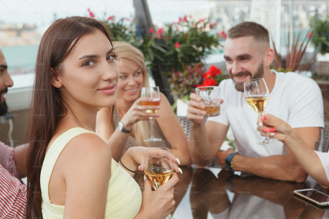 Woman Drinking With Friends: Stock Photos