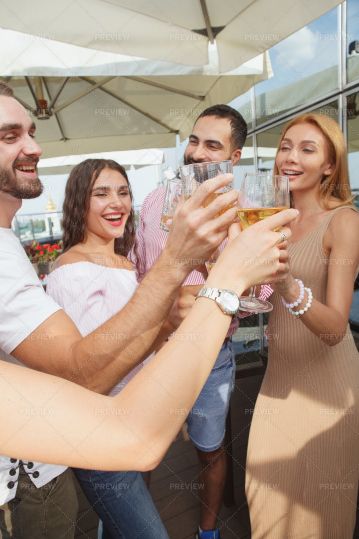 Friends Clinking Wine Glasses: Stock Photos