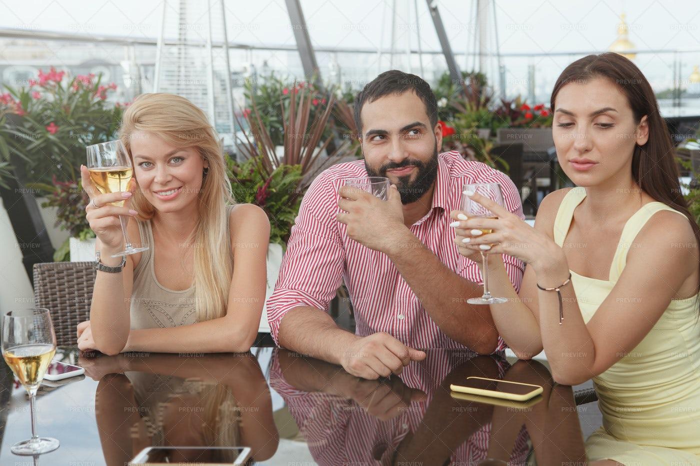 Friends Enjoying Drinks At The Bar: Stock Photos